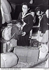 edited SYDNEY NSW. 1946-03-06. CRYING BITTERLY INTO HIS MOTHER'S DRESS LITTLE FORMOSAN BOY IS TO EMBARK FOR FORMOSA WITH HIS FAMILY ON THE JAPANESE REPATRIATION DESTROYER YOIZUKI